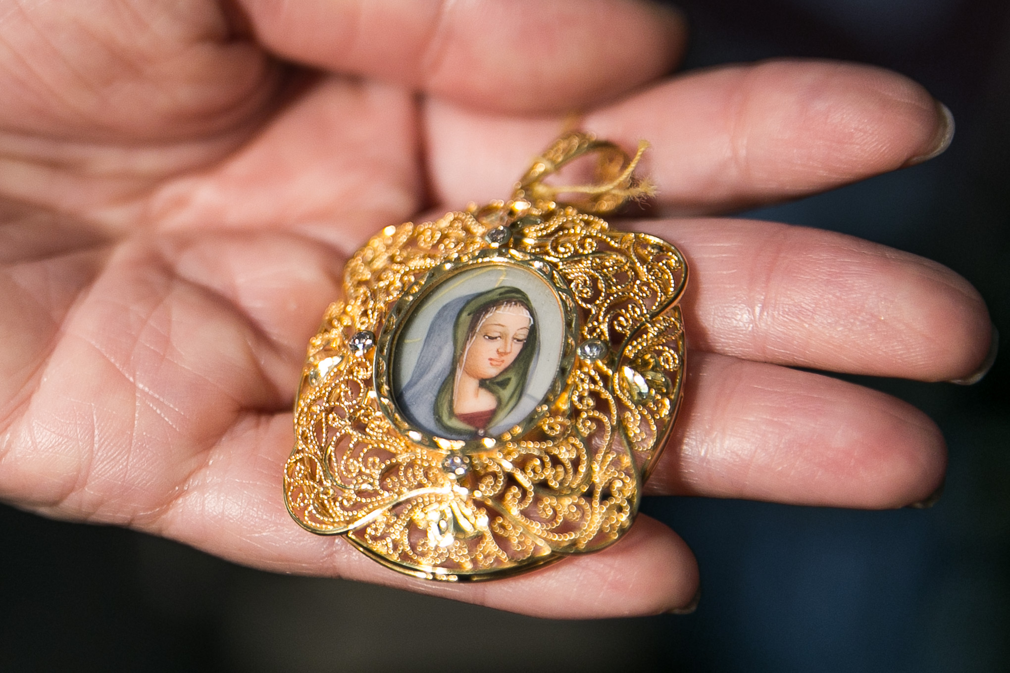 PENDANT. A miniature painting was turned into a pendant and encased in gold. Photo by Pat Nabong/Rappler