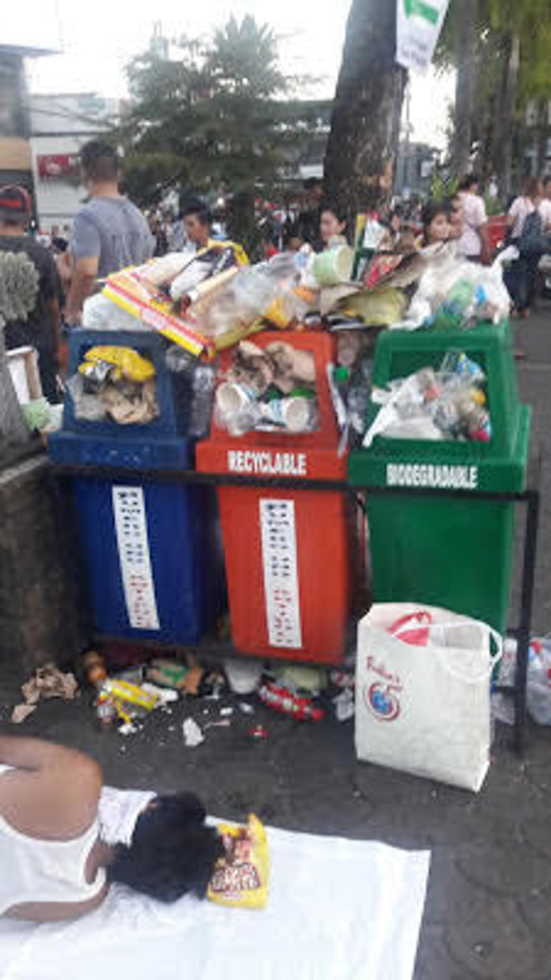 Trash bins overflowing with rubbish. Photo courtesy of EcoWaste Coalition blog