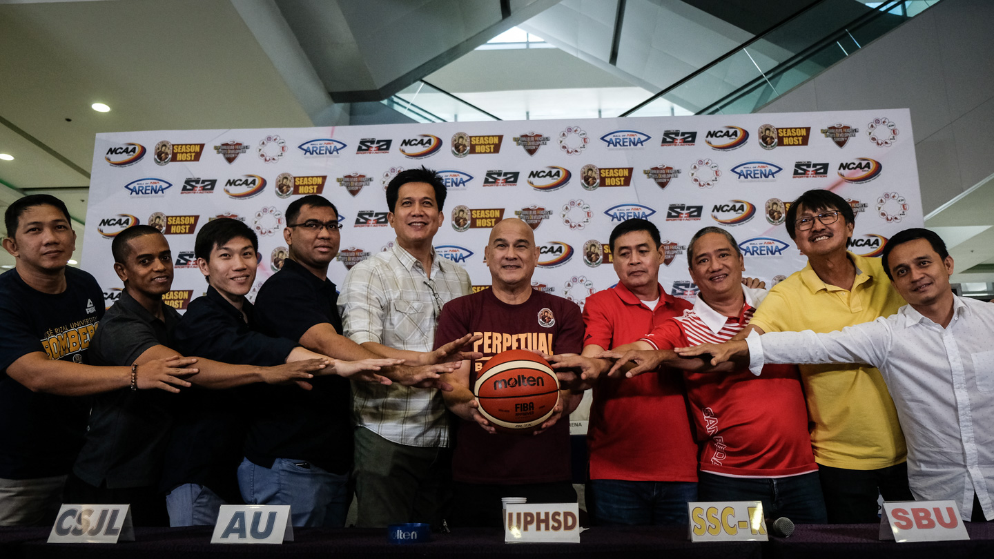 NEW BATTLE. NCAA coaches (from left) Vic Lazaro representing JRU's Vergel Meneses, Lyceum's Topex Robinson, St. Benilde'sTY Tang, Letran's Jeff Napa, Arellano's Jerry Codinera, Perpetual's Frankie Lim, San Sebastian's Egay Macaraya, San Beda's Boyet Fernandez, Mapua's Atoy Co, and EAC's Ariel Sison go at it again this season. Photo by Josh Albelda/Rappler