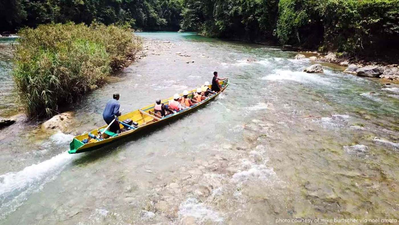 ULOT RIVER. Riding a baroto through a quiet part of the river. Photo by Potpot Pinili