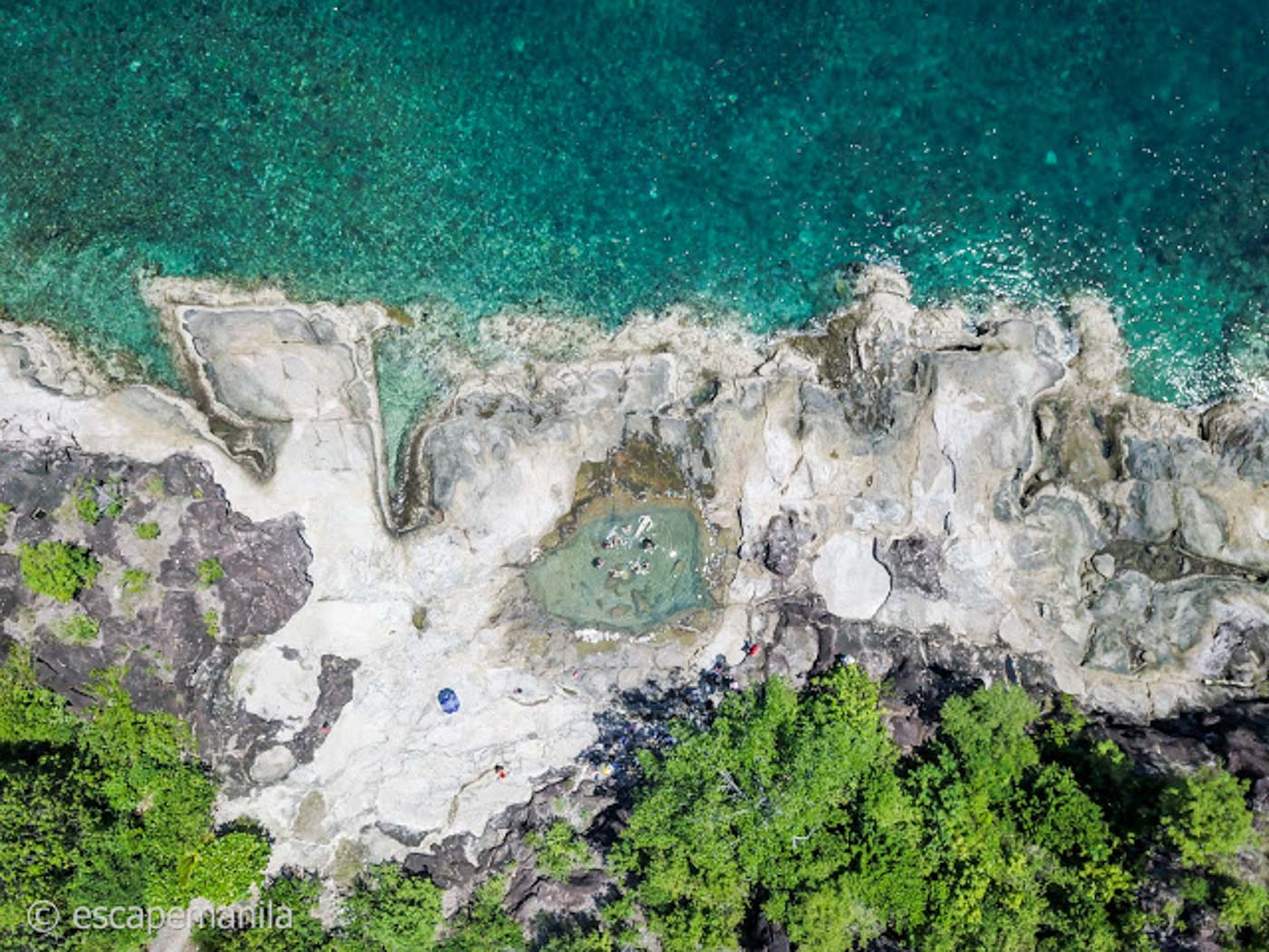 ROCK POOL. A crater in these rocks at Bisaya-Bisaya Island make a natural pool perfect for swimming. Photo by Glen Santillan