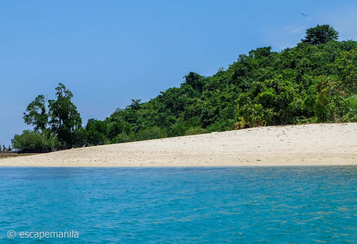CLEAR WATERS. The island's waters are clean and crystal-clear. This is Baung-Baung Island. Photo by Glen Santillan