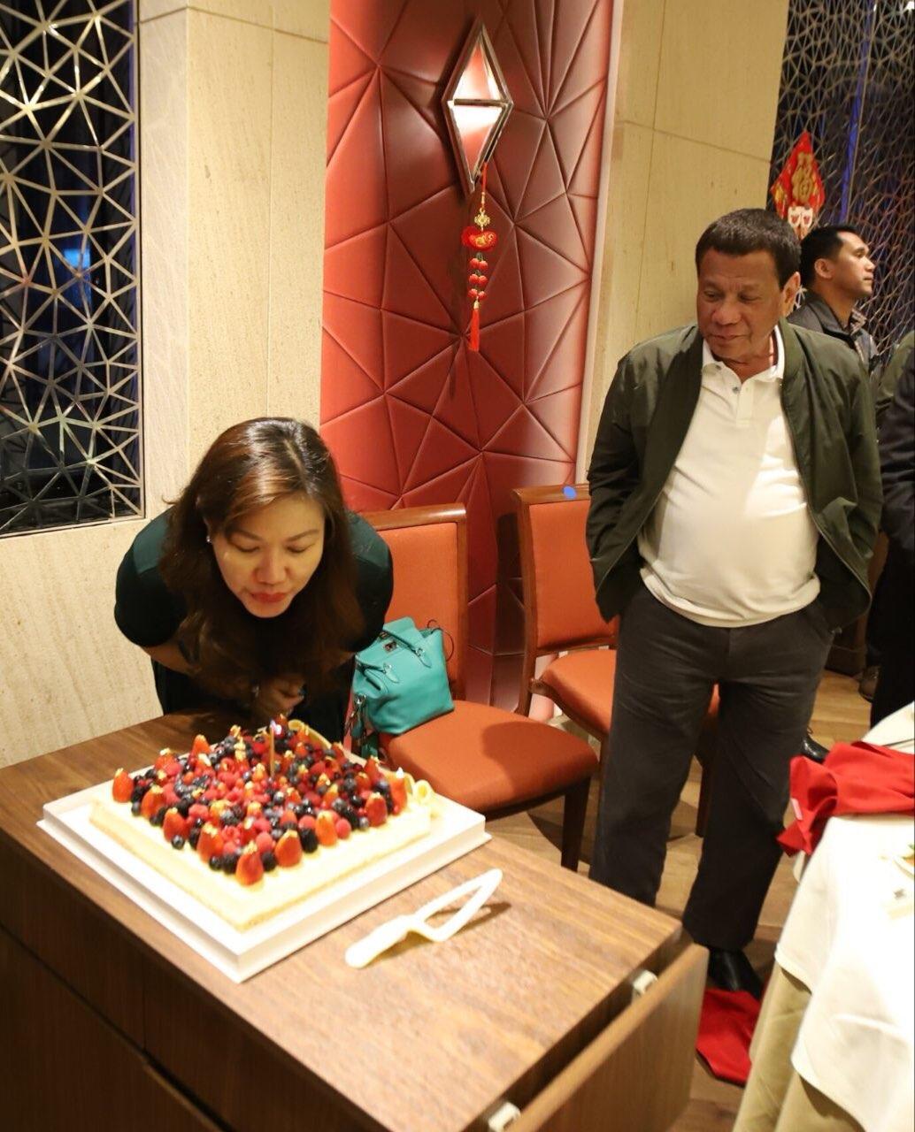 BIRTHDAY. President Rodrigo Duterte looks on as his longtime partner Honeylet Avanceu00f1a blows a birthday cake in Hong Kong on February 16, 2019. Photo from Bong Go