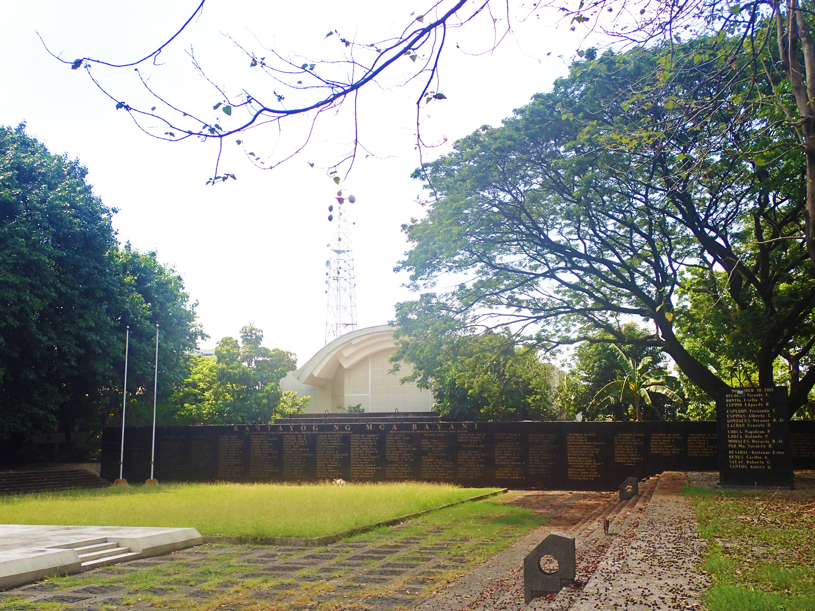 WALL OF REMEMBRANCE. At the end of a grassy expanse is a granite wall bearing the names of Marcos era heroes and martyrs.