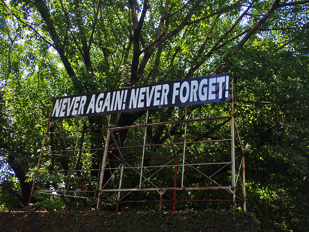 PROTEST. These words are visible among the trees as you walk deeper into Bantayog'u0080u0099s compound.