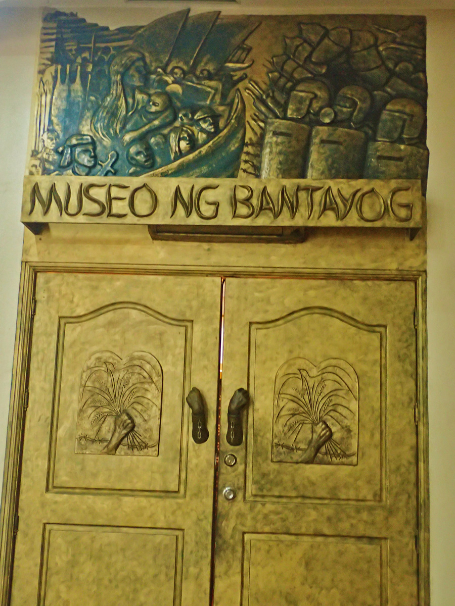 MUSEUM ENTRANCE. The door to the museum has images of struggle and peace during the Marcos regime.