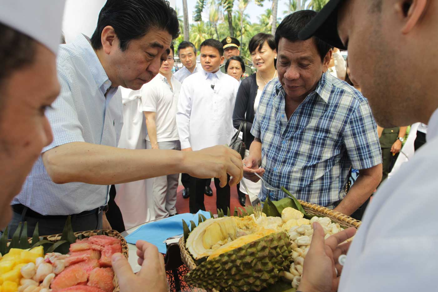 WHEN IN DAVAO. Japanese Prime Minister Shinzo Abe eats durian with President Rodrigo Duterte after attending various events at the Waterfront Hotel in Davao City on January 13, 2017. Malacau00f1ang photo