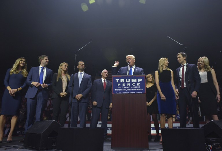 Republican presidential nominee Donald Trump speaks during a rally at the SNHU Arena in Manchester, New Hampshire on November 7, 2016. From left: daughter-in-law Lara Yunaska, son Eric Trump, daughter in law Vanessa Trump, Donald Trump, Ivanka Trump, son-in-law Jared Kushner, and Tiffany Trump. Mandel Ngan/AFP