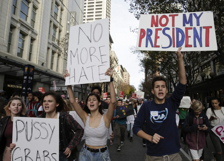 Local students and their supporters march during a walkout protest against US President-elect Donald Trump in Seattle, Washington on November 14, 2016. Jason Redmond/AFP