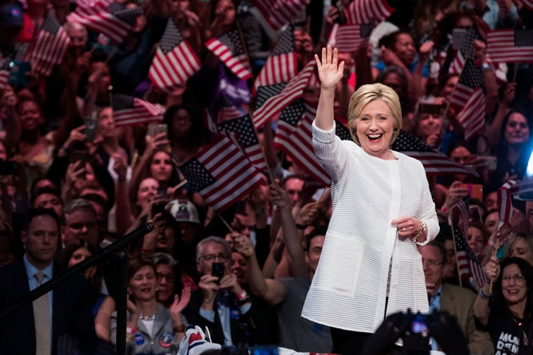 MAKING HISTORY. Democratic presidential candidate Hillary Clinton arrives onstage during a primary night rally at the Duggal Greenhouse in the Brooklyn Navy Yard, June 7, 2016 in the Brooklyn borough of New York City. Drew Angerer/Getty Images/AFP