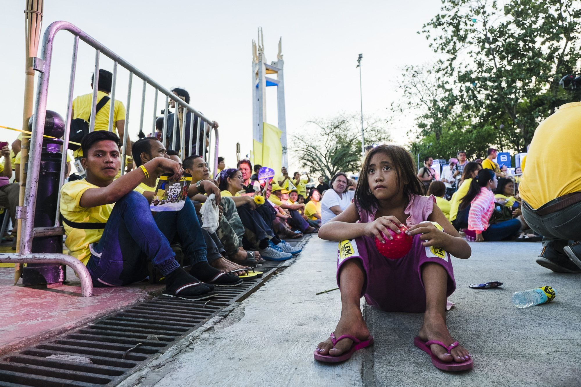 THE FUTURE. A street child sits with Robredo's supporters during her send-off at QC Circle.