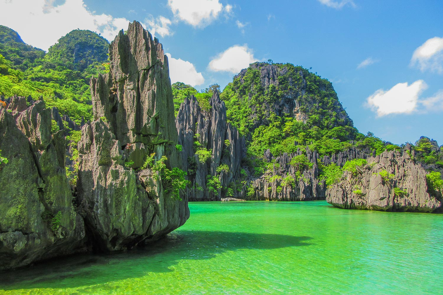LAGOON. Cadlao Lagoon has emerald waters and towering limestone formations surrounding it.