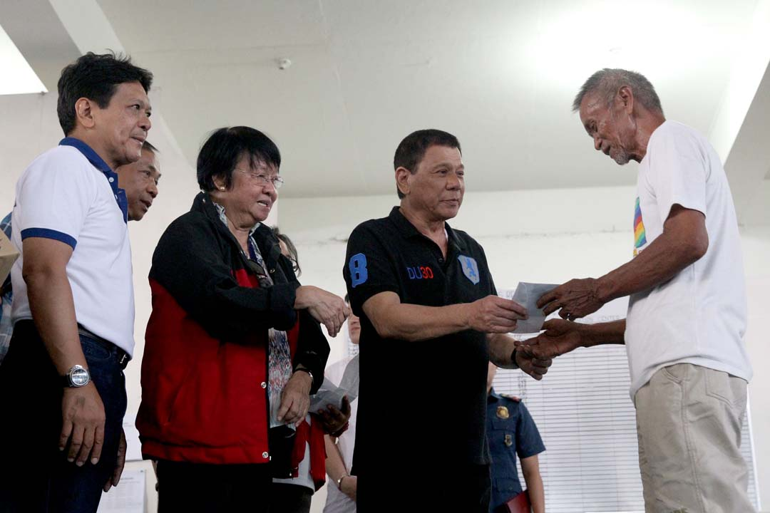DISASTER RESPONSE. President Rodrigo Duterte distributes aid to families affected by Super Typhoon Lawin (Haima) at the Tuguegarao City People's Gymnasium in Cagayan on October 23, 2016. Photo by Richard Madelo/Presidential Photo