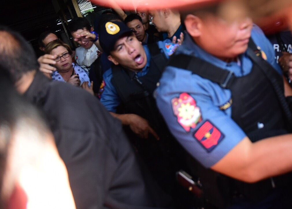 DRUG CHARGES. Senator Leila de Lima is brought by the police to a van that would bring her to Camp Crame. Photo by Alecs Ongcal/Rappler
