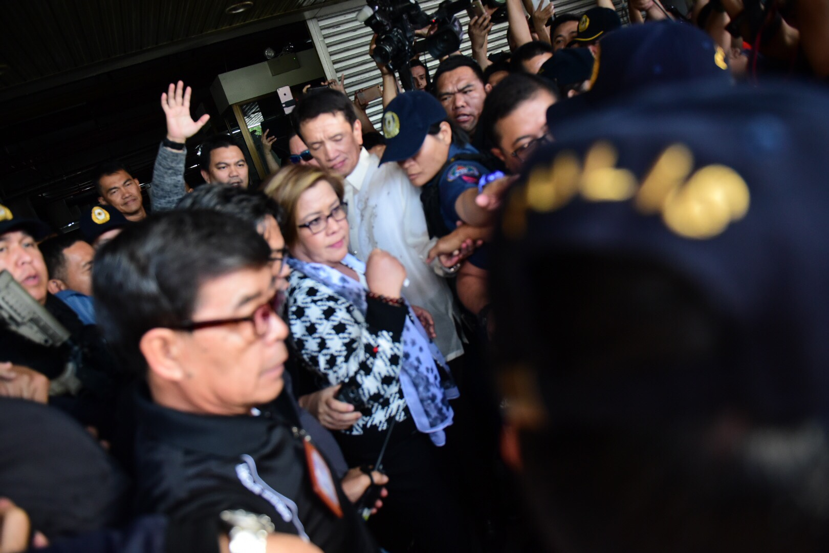 LONG DAY. Senator Leila de Lima is accompanied by her lawyer Alexander Padilla to a waiting PNP team.