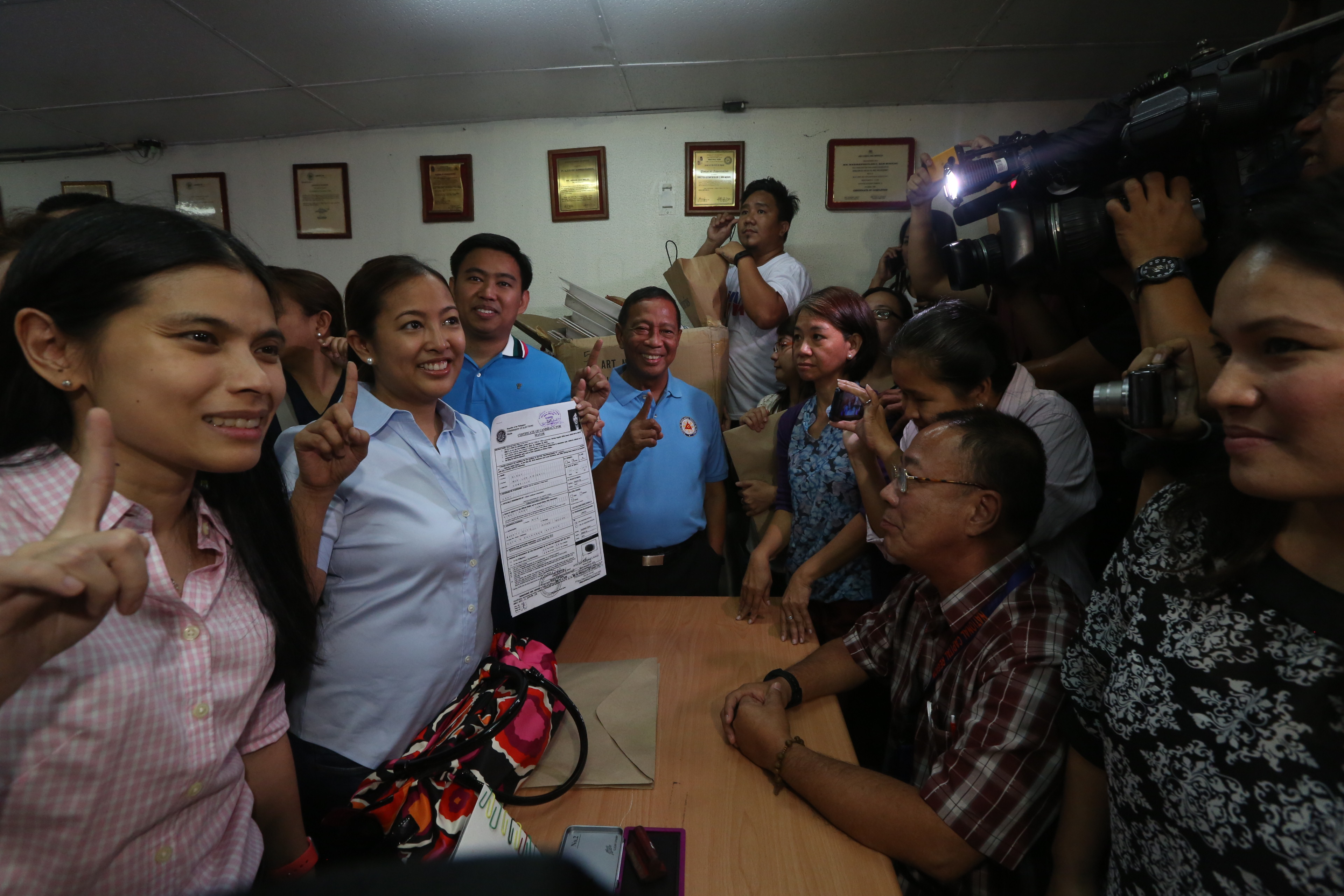 ALL-OUT SUPPORT. VP Binay (center, in blue) accompanies his daughter Abby (2nd from left) as she files her certificate of candidacy (COC) for mayor on October 15. Abby plans to follow her father's footsteps if she wins. Photo by the Office of the Vice President Media Affairs