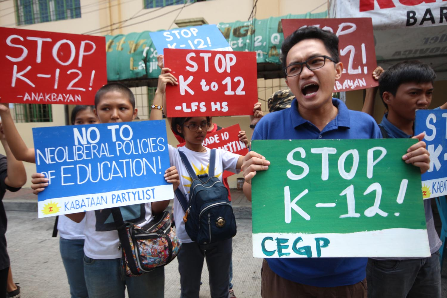 STOP K TO 12? Members of the League of Filipino Students hold a protest against K to 12 outside of the Commonwealth High School during the opening of classes in June 2016. File photo by Joel Liporada/Rappler