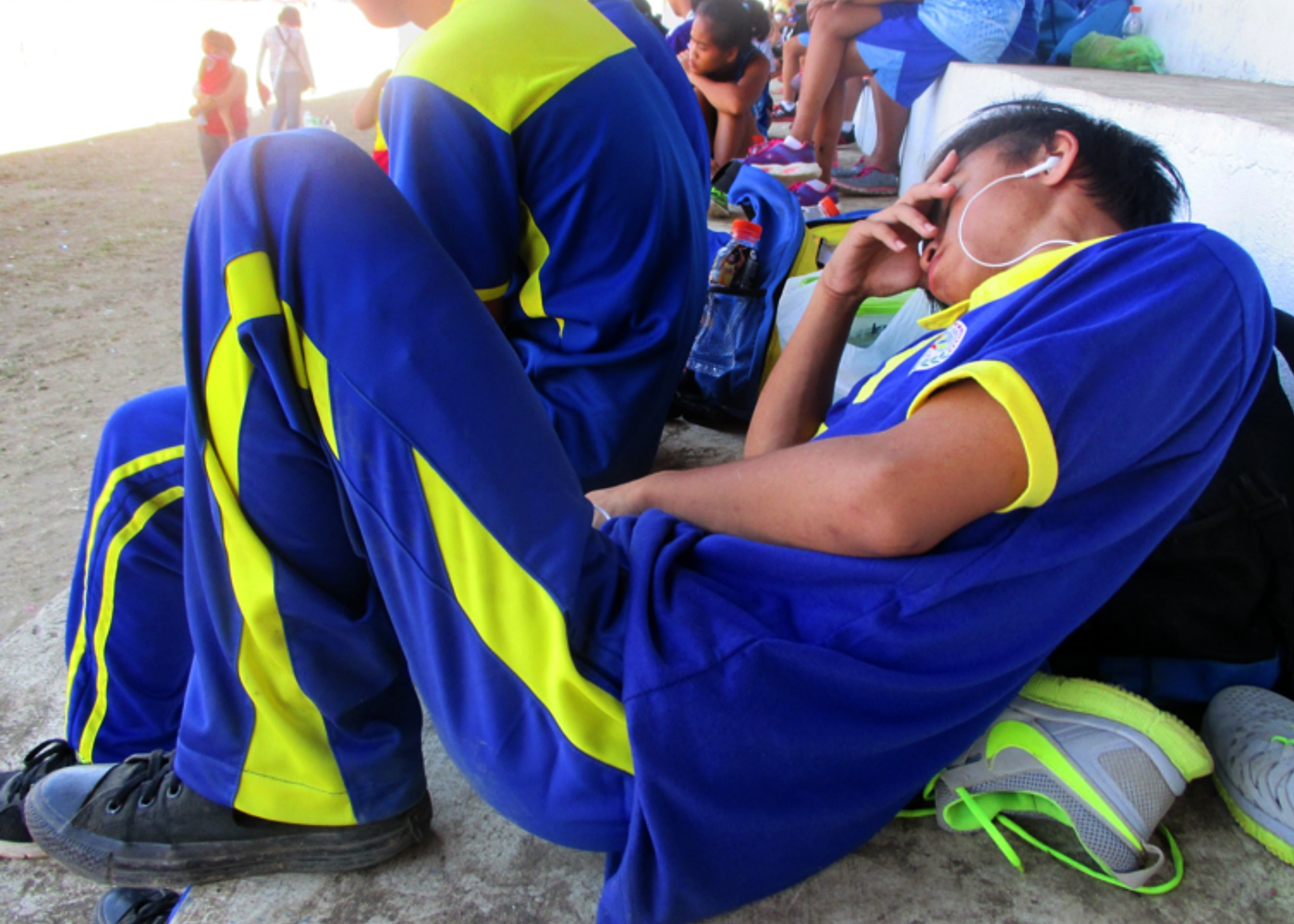 POWER NAP. Student-athletes catch some sleep in the grandstand of the Binirayan Sports Complex in San Jose, Antique.