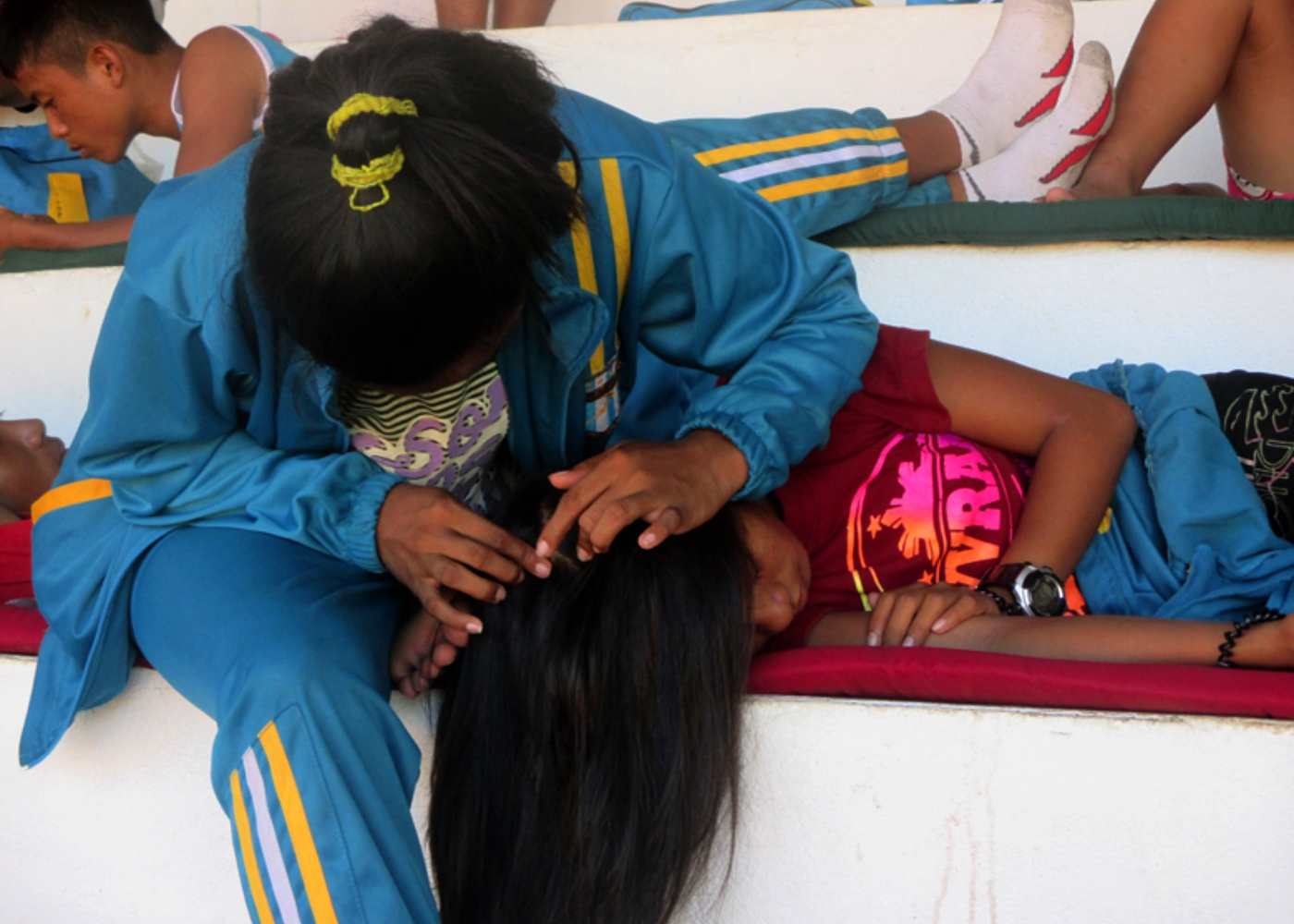 A GIRL THING. Coach and athlete shows sisterly bond while resting at the Binirayan Sports Complex.