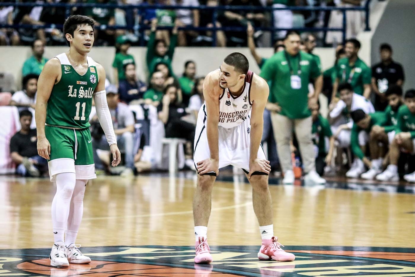 CRUNCH TIME. UP stalwart Kobe Paras and La Salle standout Aljun Melecio go at in the final stretch. Photo by Michael Gatpandan/Rappler