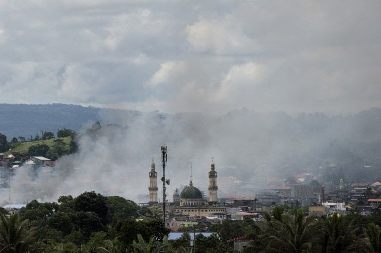 AIR STRIKE. Smoke rises after aerial bombings by Philippine Air Force planes on Islamist militant positions in Marawi, on the southern island of Mindanao on June 6, 2017. Noel Celis/AFP
