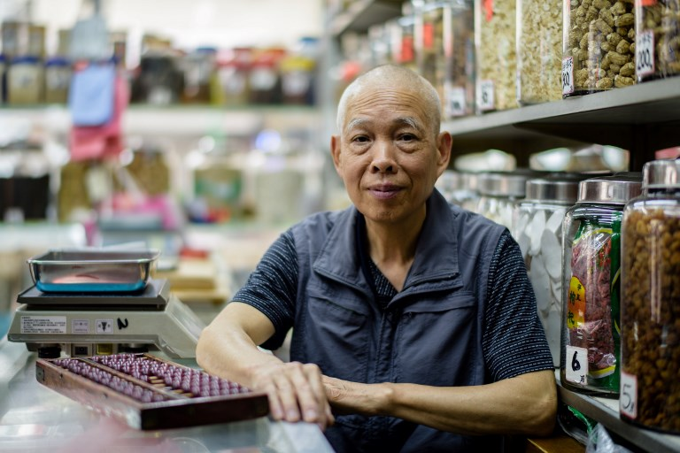 OLD HAND. In this photo taken in Hong Kong on May 10, 2017, Chinese medicine shop owner Tan Kin Hua, 72, poses in his shop. Anthony Wallace/AFP