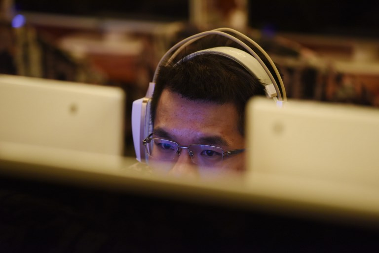 VIDEO BANS. A man uses a computer in an internet cafe in Beijing on June 1, 2017. File photo by Greg Baker/AFP