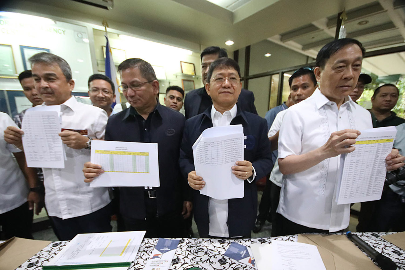 RELEASE BEFORE POLLS. Four days before the campaign period for the barangay and Sangguniang Kabataan elections, PDEA chief Director General Aaron Aquino (2nd-left), DILG Secretary Eduardo Au00f1o (2nd-right), Congressman Ace Barbers (left) and DDB Secretary Catalino Cuy (right) show a list of 207 barangay officials allegedly involved in illegal drugs. File photo by Darren Langit/Rappler