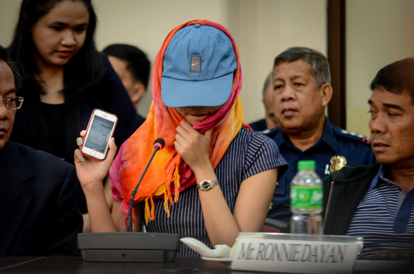 DAYAN'S DAUGHTER. Hannah Mae shows Congress investigators the text exchanges between her and Senator Leila de Lima. Photo by LeAnne Jazul/Rappler