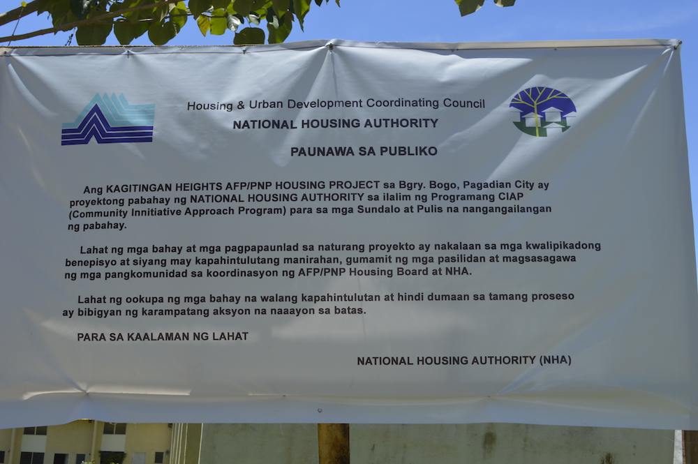 NOTICE. NHA-Pagadian personnel installed a notice to prevent unauthorized takeover of the housing units at Kagitingan Heights. Photo by Gualberto Laput/Rappler