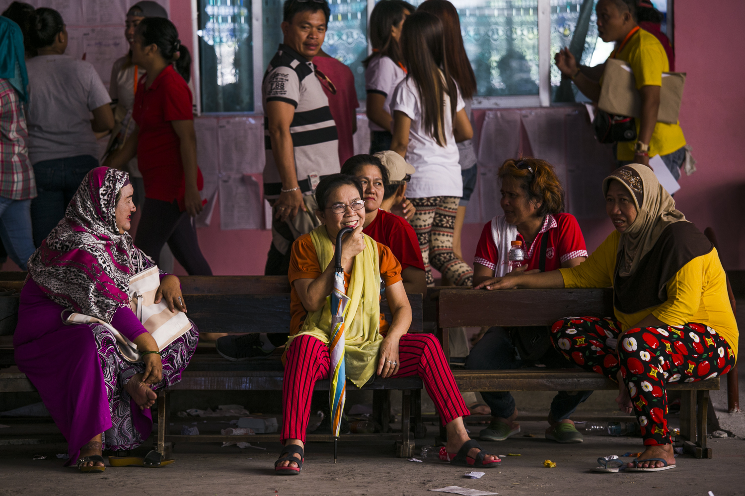 WAITING FOR THEIR TURN. Women wait in the open area of Maharlika Elementary school located in a predominantly Muslim community. Photo by Pat Nabong/Rappler