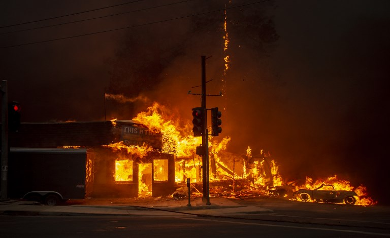 CALIFORNIA FIRE. A store burns as the Camp fire tears through Paradise, California on November 8, 2018. File photo by Josh Edelson/AFP