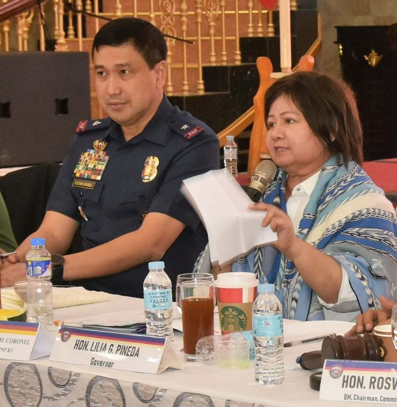 DISAGREES. File photo of Police Regional Office 3 - Central Luzon director Brigadier General Joel Napoleon Coronel with then Pampanga governor Lilia Pineda during a barangay officials gathering in 2018. Photo by Jun A. Malig