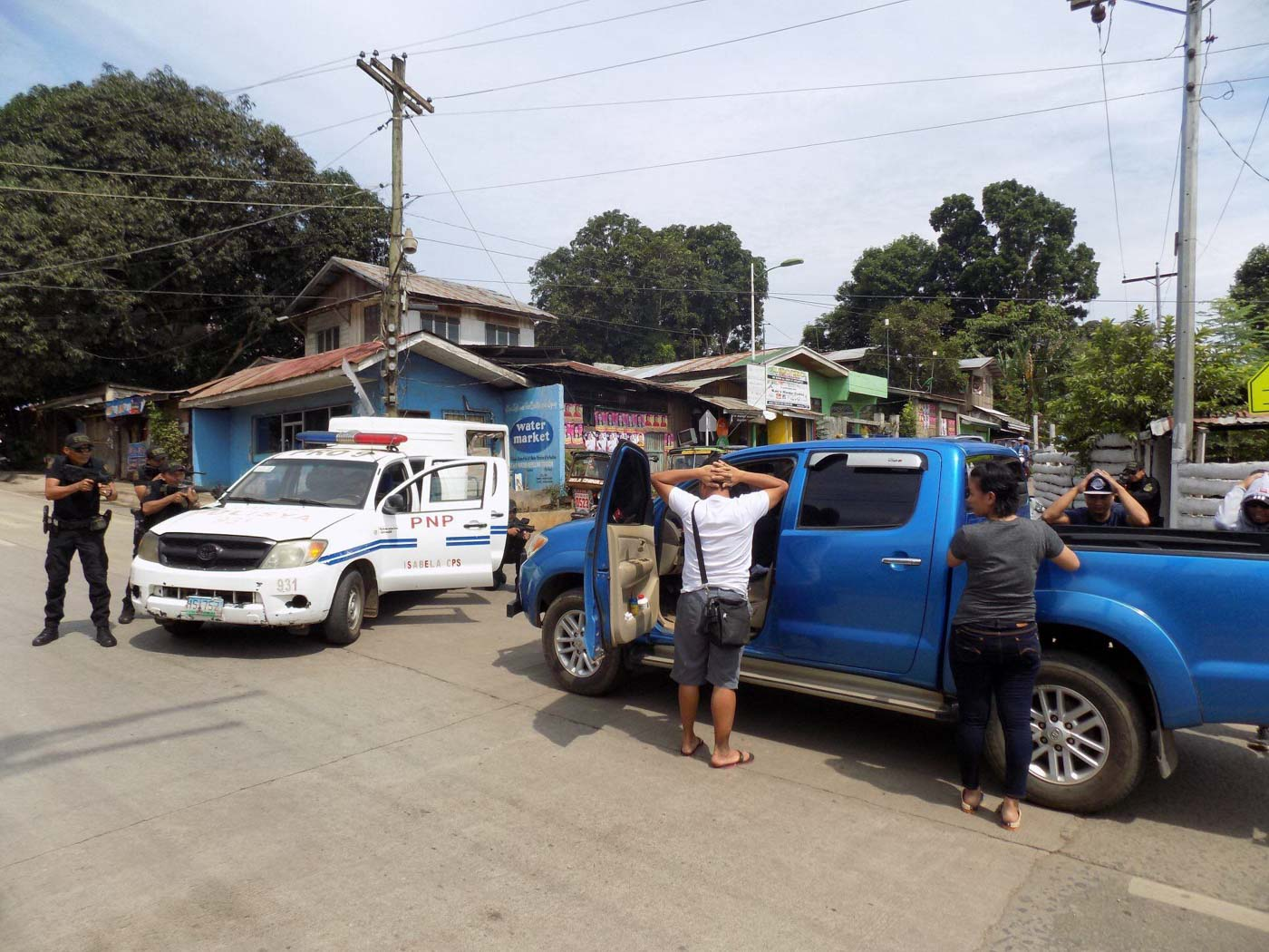 JUST A DRILL. Police apprehend 'suspects' in a simulated election day incident. Photo courtesy of Isabela City police