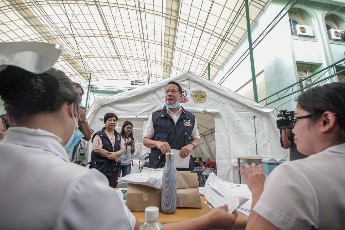 EXTRA MEASURES. Department of Health Secretary Francisco Duque inspects tents set up for measles patients at San Lazaro Hospital in Manila on February 13, 2019. Photo by Lito Borras/Rappler