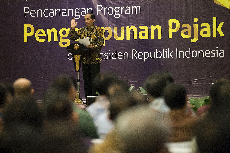 Presiden Jokowi menyampaikan sambutannya dalam acara Pencanangan Program Pengampunan Pajak (Tax Amnesty) di Kantor Pusat Ditjen Pajak, Jakarta, pada 1 Juli 2016. Foto oleh Widodo S. Jusuf/Antara