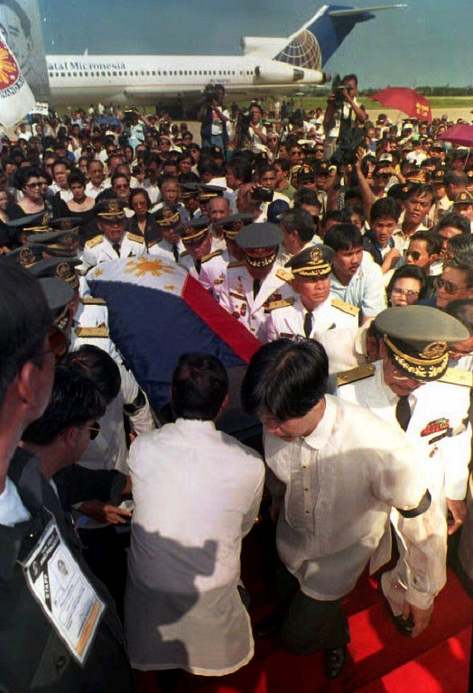 IN LAOAG. The coffin of Marcos is carried to a stage by his son Bongbong and retired military generals at the Laoag airport on September 7, 1993. Imelda Marcos and her 2 daughters are in black. AFP file photo