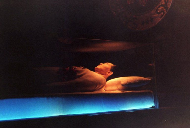 PUBLIC. The embalmed body of Ferdinand Marcos is seen through a sealed glass coffin inside a dimly lighted mausoleum in his northern Philippine hometown on September 11, 1993. Photo by Romeo Gacad/AFP