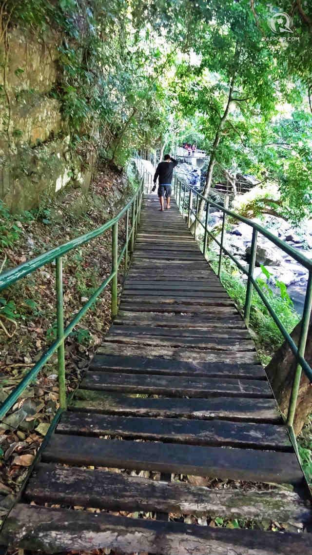 WOODEN BRIDGE. A walk on a long wooden bridge will take you to Kasabangan.