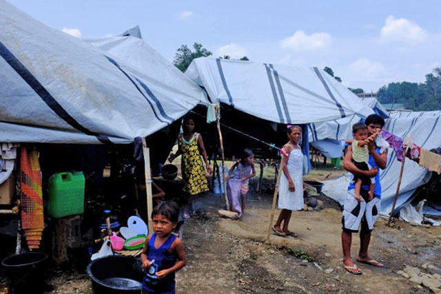 DISPLACED. Internally displaced Lumad outside their tent in the Tandag city sports center evacuation center. Photo by Bobby Lagsa / Rappler