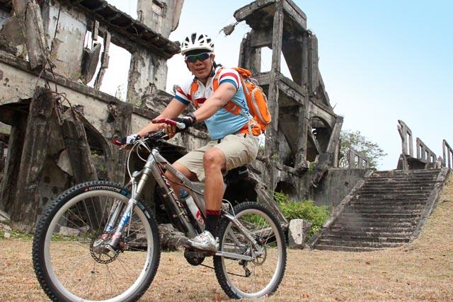 Photographer John Hendrix at the ruins of Mile Long Barracks. Photo by Rome Jorge