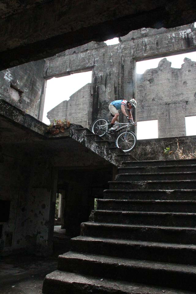 Photographer John Hendrix descending the staircase at the ruins of the Corregidor Hospital. Photo by Rome Jorge