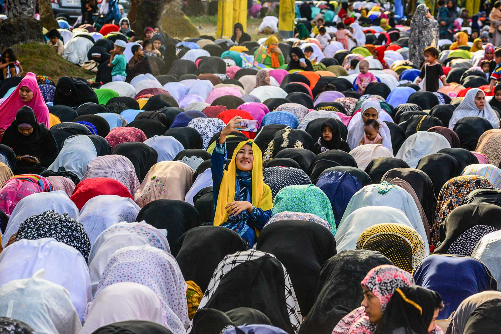 OBLIGATORY. A Muslim women takes a selfie before praying during the Eid'l Fitr celebration at the Blue Mosque in Taguig City. Photo by Maria Tan/Rappler