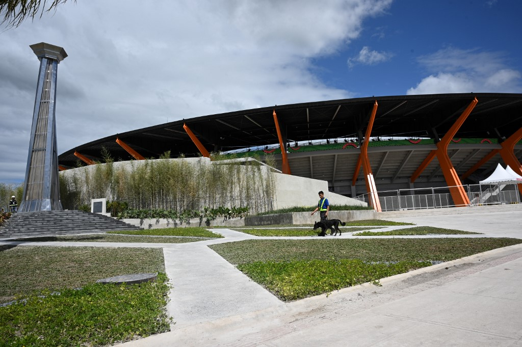 CAULDRON. A security personnel walks past the cauldron in front of the athletics stadium in New Clark City, in Capas town, Tarlac province north of Manila on November 26, 2019. Photo by Ted Aljibe/AFP
