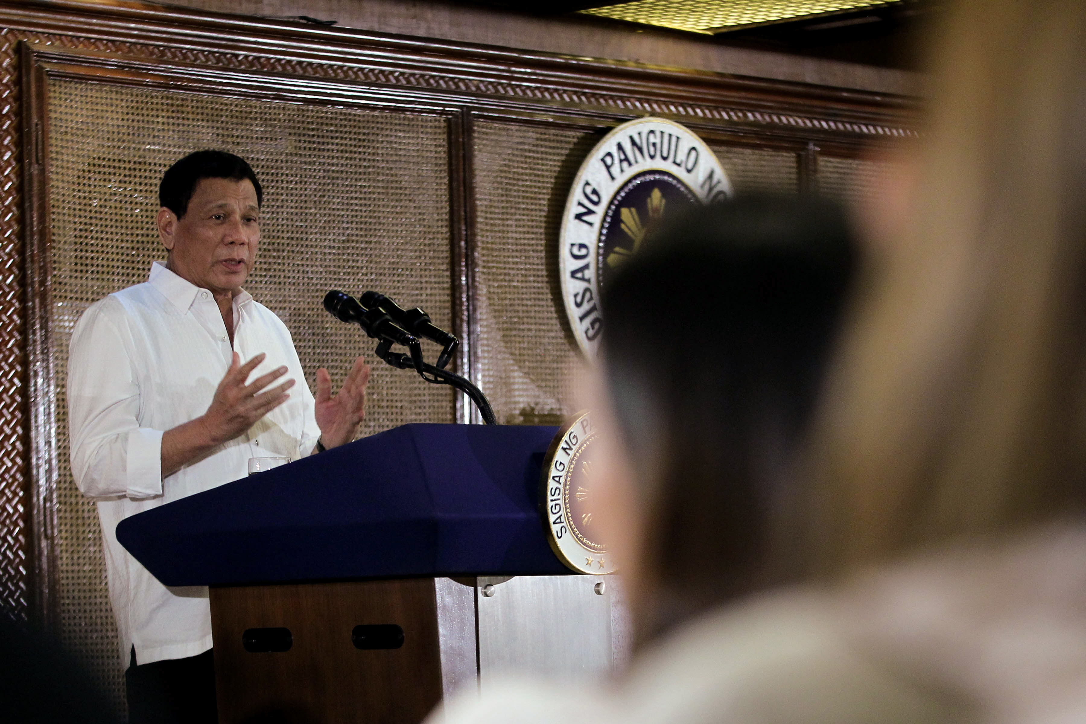 SAF 44. President Rodrigo Duterte speaks to families of the slain PNP Special Action Force troopers on January 24, 2017. File photo by Ace Morandante/Presidential Photo
