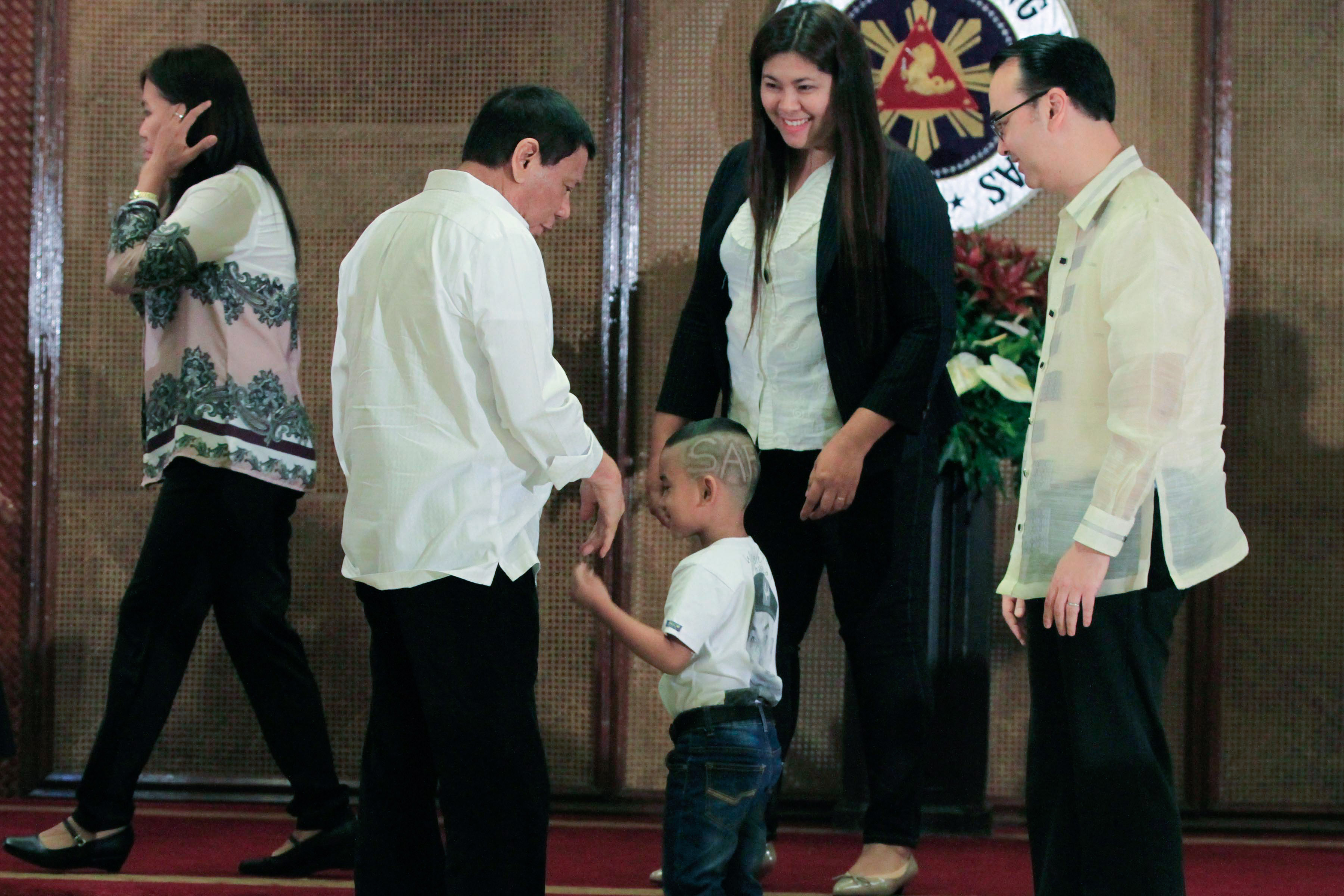'MANO PO.' President Rodrigo Duterte meets the family of a fallen Special Action Force trooper. Photo by Rolando Mailo/Presidential Photo
