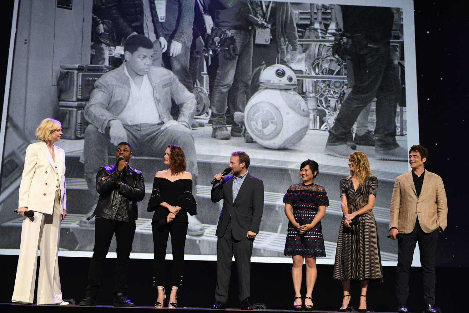 'THE LAST JEDI.' The cast of 'Star Wars: The Last Jedi' takes the stage at D23 Expo 2017. From left to right: Gwendoline Christie, John Boyega, Daisy Ridley, director Rian Johnson, Kelly Marie Tran, Laura Dern, and Benicio del Toro. Photo by Disney/Image Group LA