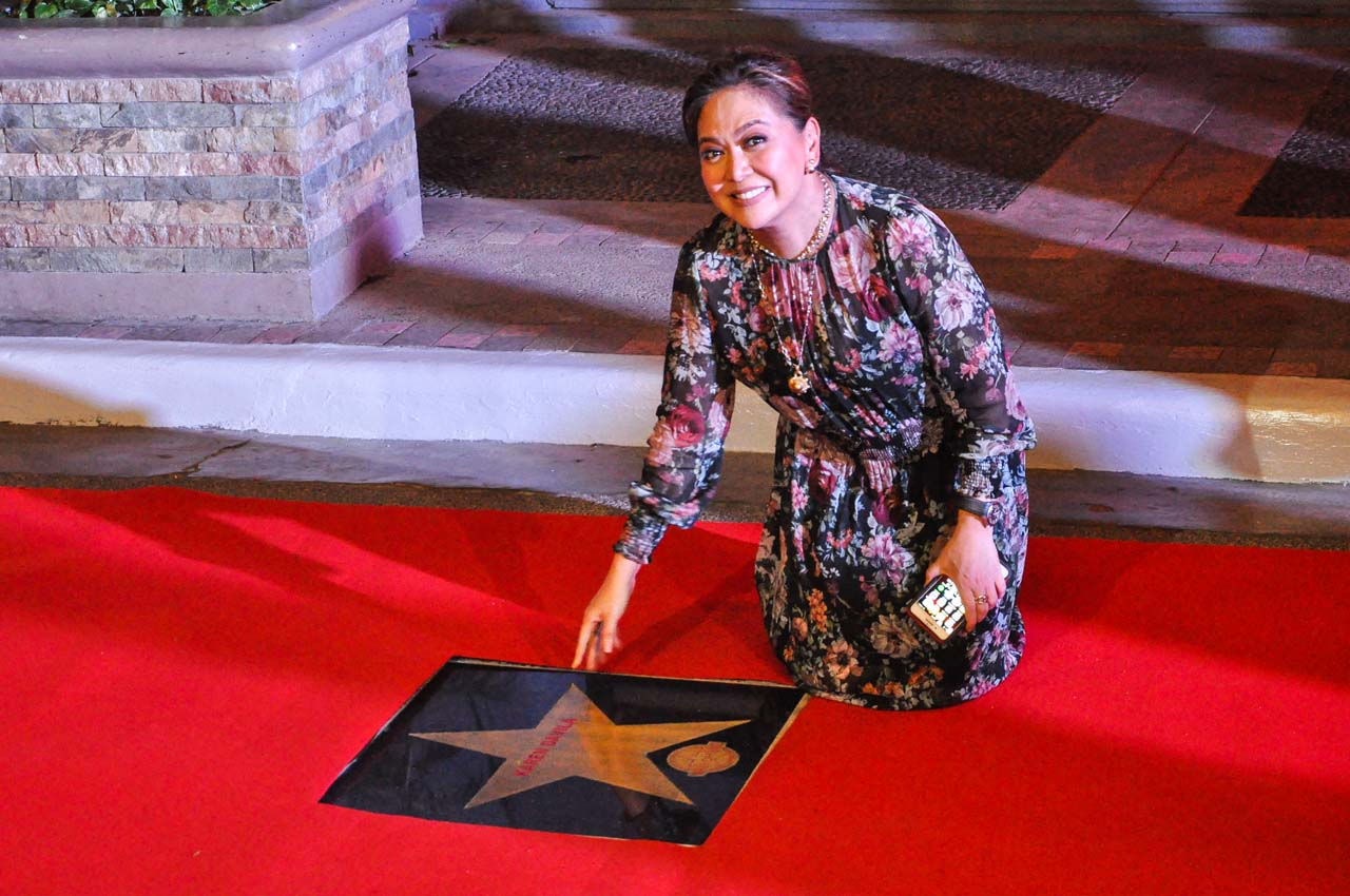 Karen Davila poses next to her star