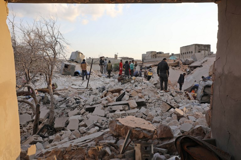 SEARCHING. Members of the Syrian civil defense search for victims amidst destruction from reported air strikes in the town of Kafraya in the north of Idlib province on March 22, 2019. Photo by Omar Haj Kadour/AFP