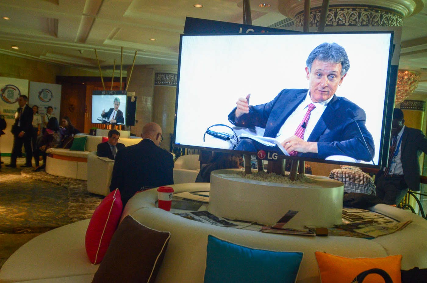 ACCESS. A live broadcast feed of an APEC event at the lobby of the Makati Shangrila Hotel.